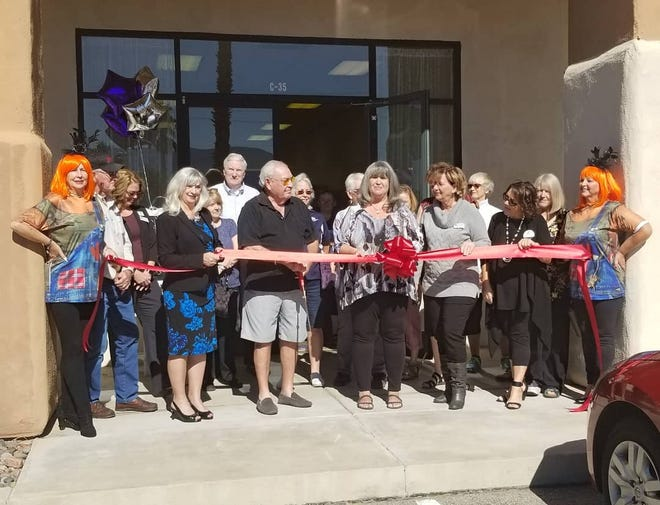 Sharon Blakemore is joined by members of the Mesquite community to celebrate the official opening for her store, Stitch N Scrap.