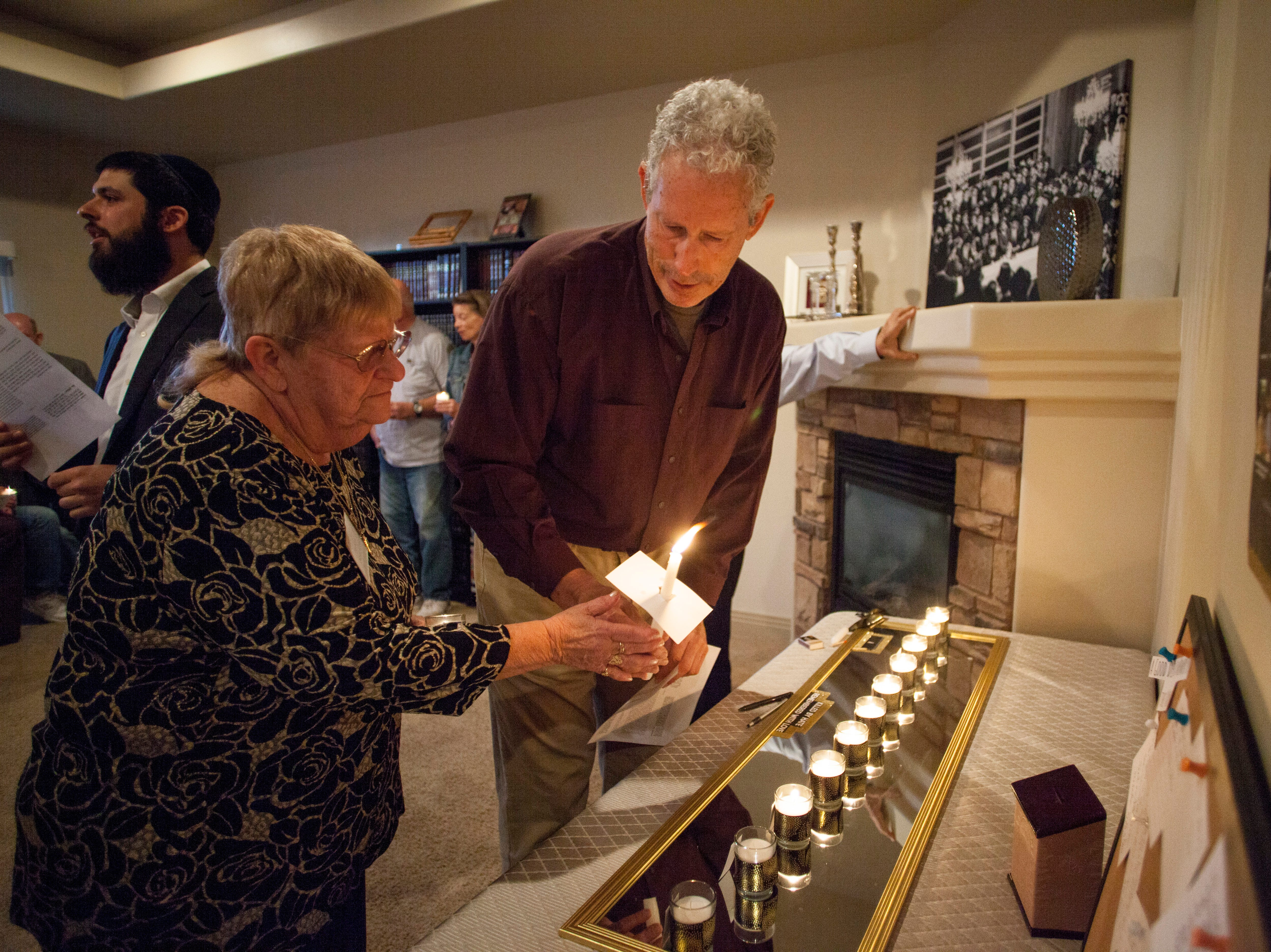 Washington County residents from various faiths gather for a candlelight vigil in honor of the Pittsburgh shooting victims Tuesday, Oct. 30, 2018.