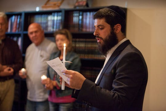 Rabbi Mendy Cohen, director of Chabad of St. George, speaks Tuesday during a candlelight vigil at his home held in honor of the 11 people killed at a Jewish synagogue in Pittsburgh on Oct. 27.