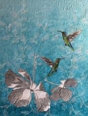 "Hummingbirds on one of the quilts by Deon Lewis at the ""Persistence of Memory"" exhibit at City Hall."