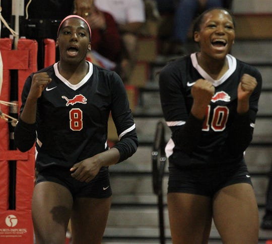 Leon senior Makayla Washington (8) and freshman sister Alexa Washington (10) celebrate a point as Leon defeated Chiles 3-1 in a Region 1-8A semifinal playoff game on Tuesday, Oct. 30, 2018.