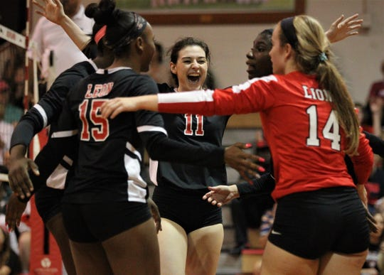 Leon's Sydney Maxwell (11) celebrates a point with her team as Leon defeated Chiles 3-1 in a Region 1-8A semifinal playoff game on Tuesday, Oct. 30, 2018.