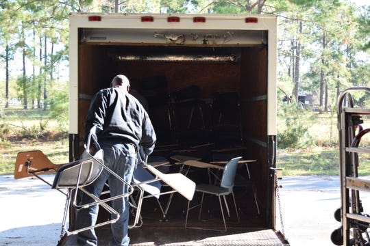 Desks for students at Griffin Middle School are loaded into a truck from a TCC warehouse. The desks were one of many items donated to the school by the college.