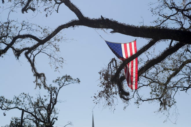 American flags line North Second Street of Wewahitchka, Fla. Tuesday, Oct. 30, 2018, three weeks after Hurricane Michael devastated Gulf County.