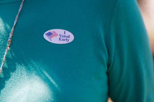 """A voter displays an """"I voted early"""" sticker after voting at the Gulf County Supervisor of Elections office in Port St. Joe, Fla. just three weeks after Hurricane Michael devastated the community and Gulf County."""