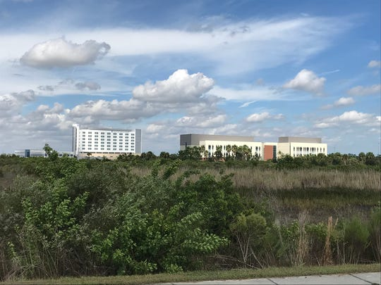 Tradition Medical Center (left) is a major selling point for residential developers in western Port St. Lucie.