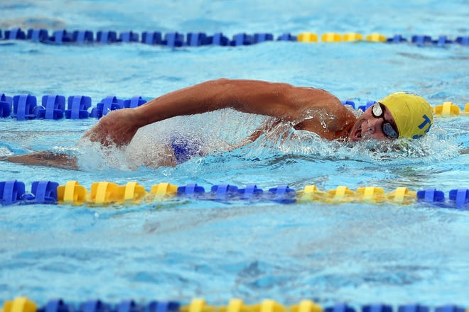 Titusville High School's Caleb Brandon competes in the last heat of the boys 100-yard freestyle on Wednesday, Oct. 31, 2018 at the District 5-2A championship on the campus of Indian River State College in Fort Pierce.