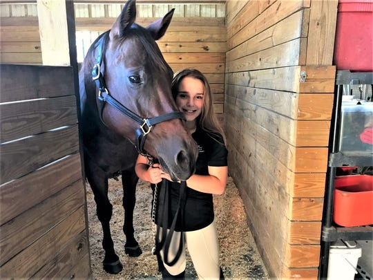 Gaby's horse is named Dazzlin' Dolly. ERAF had rescued her, and after some training for Dolly and lessons for Gaby, the Alvinos decided to adopt her. ERAF boards adopted horses at its barn and also offers riding lessons.