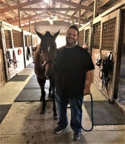 John Alvino and his daughter Gaby have adopted two horses, Dazzlin' Dolly for Gaby and Son for John. They care for their adopted horses that they own and the other horses at the barn. Neither John or Gaby had any experience with horses before coming to ERAF.