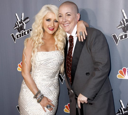 """Finalist Beverly McClellan (right) and her coach, Christina Aguilera, pose for photographers after finale of """"The Voice"""" in Burbank, California, on June 29, 2011. McClellan died Tuesday, Oct. 30, 2018, after losing a battle with cancer."""