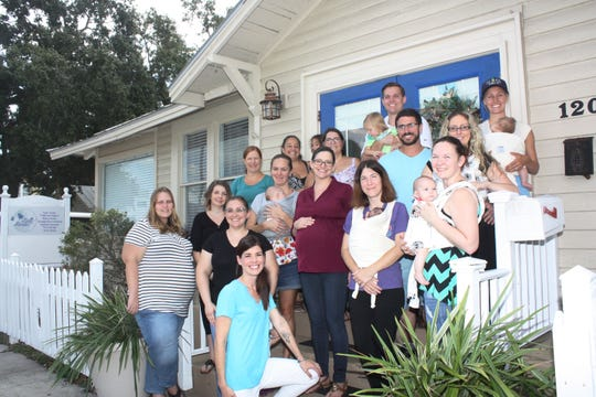 Mothers-to-be and new mothers and fathers enjoyed learning about and receiving a free Baby K'tan®  from instructors Britt Beason and Nancy Fry at Bell House Birth Services in downtown Stuart.