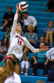 South Fork's Angela Grieve (14) goes for the kill Tuesday, Oct. 30, 2018, during her team's high school region 4-7A semifinal volleyball match against Jensen Beach at Jensen Beach High School.