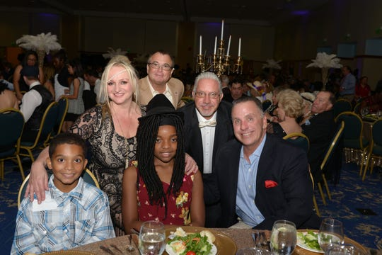 Club Kids Braden and Brianna, seated, left, joined Lori Finkle, Ken Guntkowski, Eric Finkle and Mark Tremblay at their table during the the 11th annual Steak & Stake Dinner & Auction at the Port St. Lucie Civic Center.