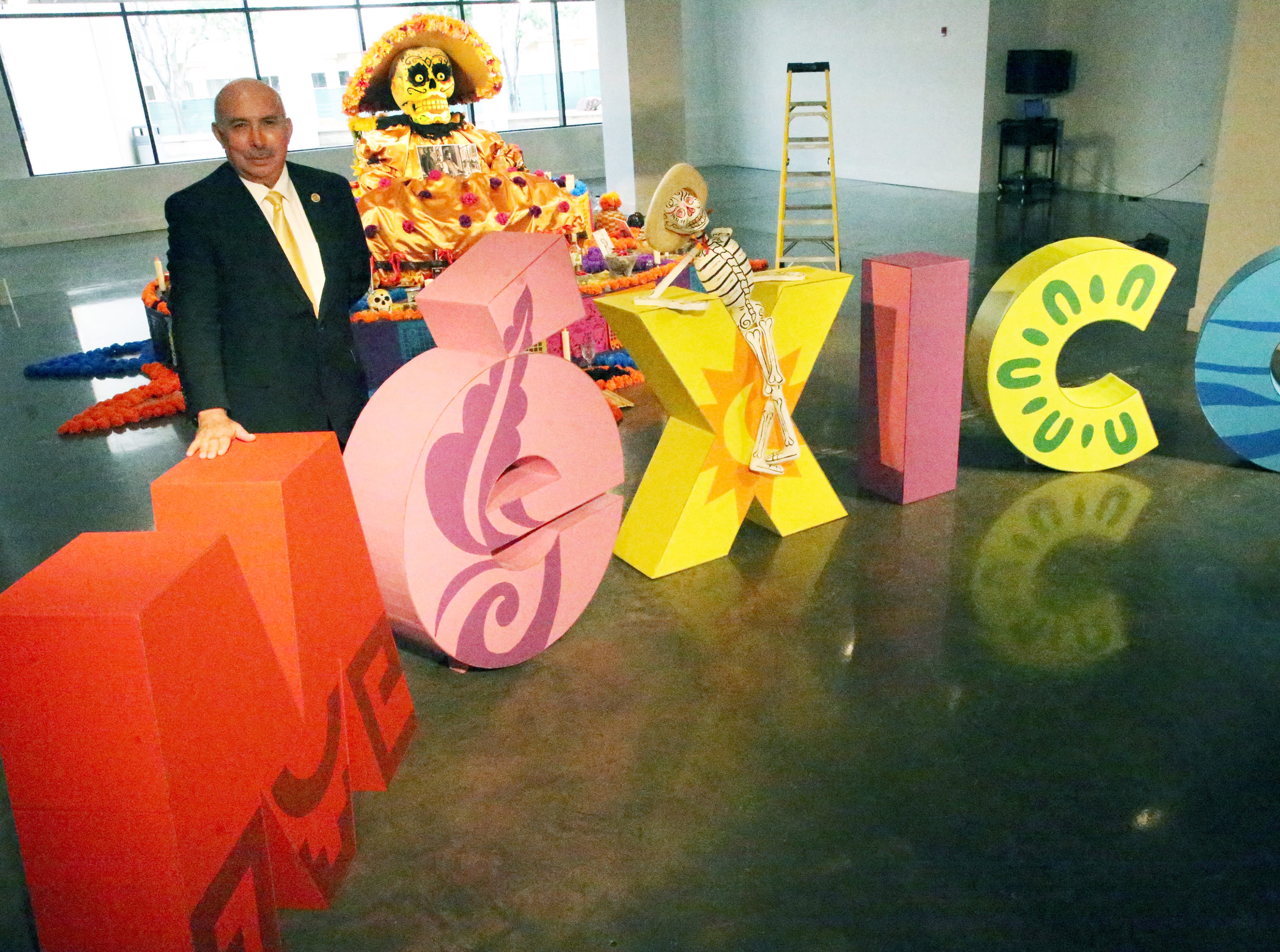 Juan C. Acereto, Consul for Commercial and Economic Affairs for the Consul General of Mexico in El Paso went to the El Paso Museum of Art Wednesday to take a peek at a Dia De Los Muertos altar dedicated to  Mexican artist Jose Guadalupe Posada in anticipation of Thursday's opening reception. Posada, who died in 1913 was an illuststrator who had an influence on many Latin American artists. The alter, which features examples of Posada's work spread throughout will be officially dedicated Thursday at 6 p.m. Festivities include performances by mariachi and a ballet folklorico groups. Hot chocolate and Day of the Dead bread will be served. The event is open and free to the public. A Day of the Dead altar is constructed at the Museum each year in collaboration with Mexican Consulate. The altar will be on view at the museum through Sunday, November 4th. On Saturday the museum will host a Fiesta de Muertos from 2-5 p.m. which includes a procession around the museum. Visitors are encouraged to wear Day of the Dead costumes and bring along candles, LED lights, flowers and rememberances of loves ones.