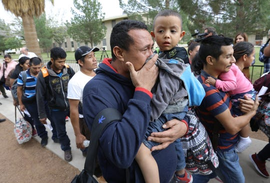 Jeramias Gomez Martinez breaks into tears after arriving with his son, Josue, at a temporary shelter at the Catholic Diocese of El Paso. With the Annunciation House overflowing, the diocese opened its doors to migrants from Central America who were released from U.S. Immigration and Customs Enforcement custody.