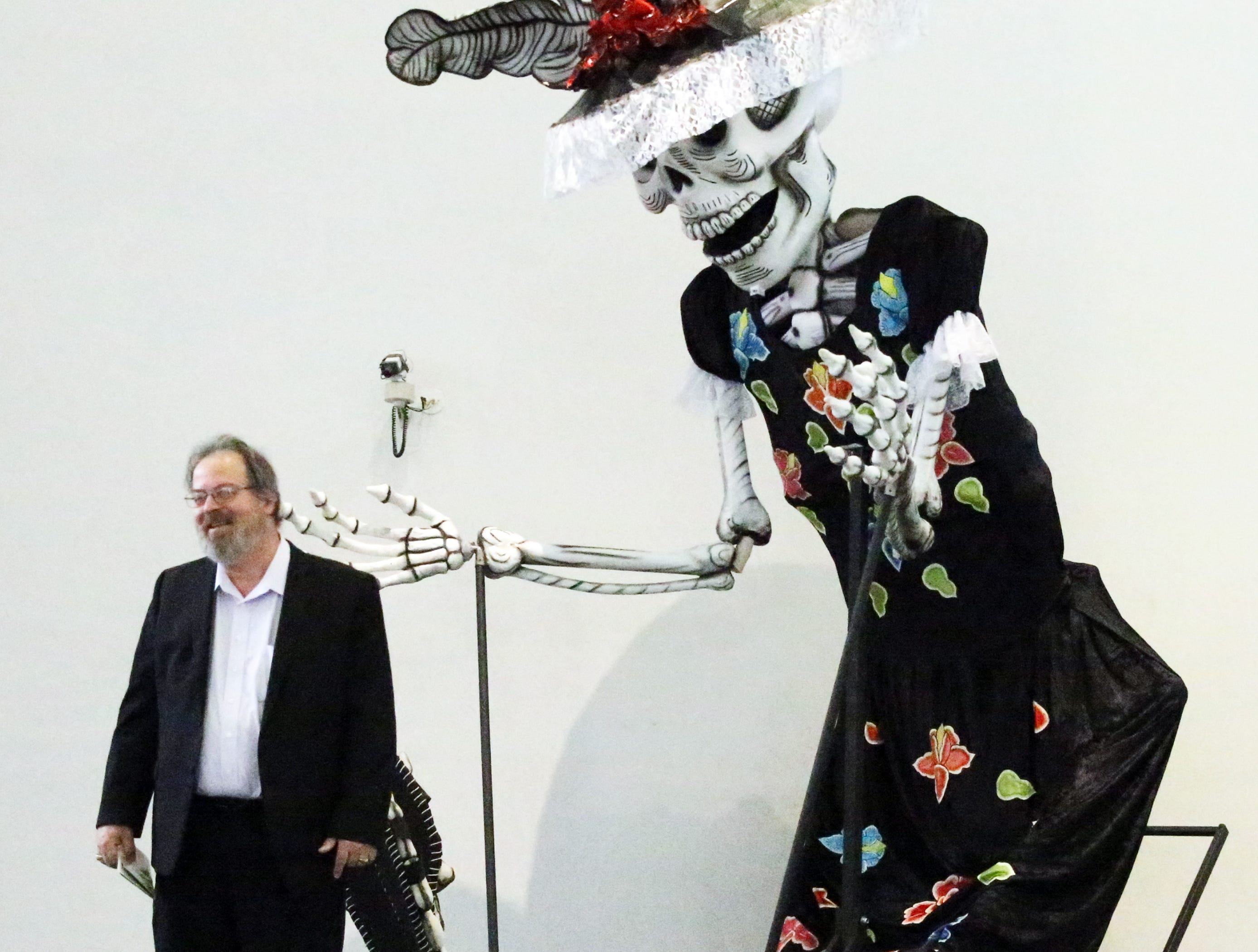 Grant Collinsworth of El Paso stands by a large scale Catrina inside the El Paso Museum of Art Wednesday.