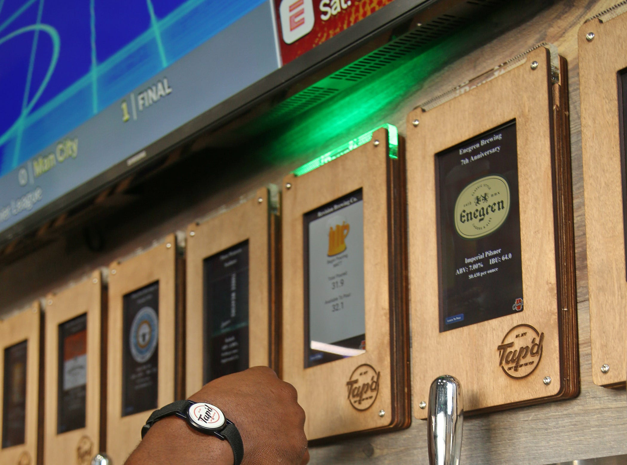 Taps at Tap'd Ventura include touch screens that offer patrons instruction on how to pour the perfect pint. By-the-ounce pricing and other information is also listed.