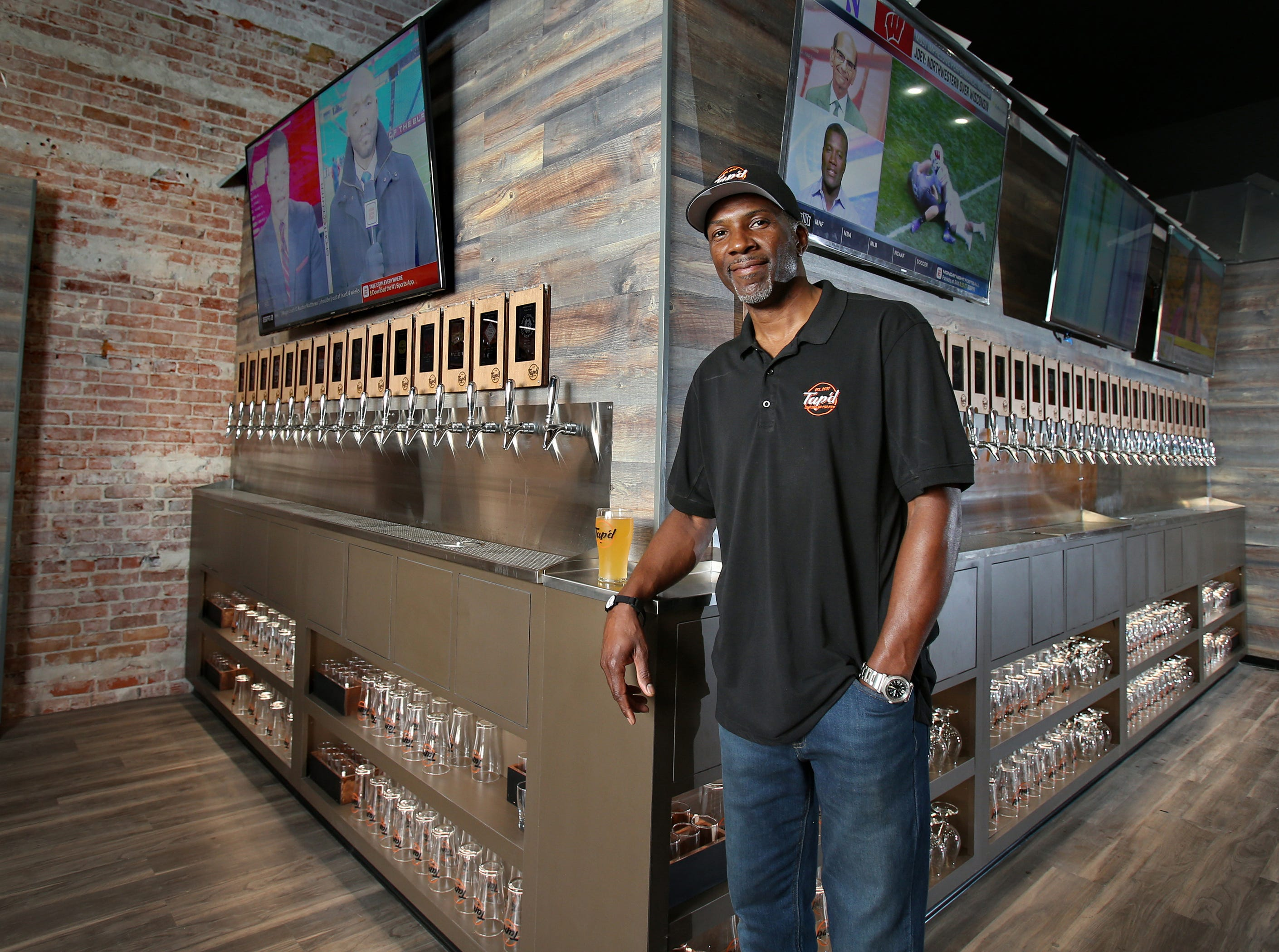 Robert Washington, CEO and co-owner of Tap'd Ventura, stands in front of the business' 43 taps. The Ventura site is the first in Ventura County to use the iPourIt system, which gives customers RIFB wristbands so they can activate taps for their chosen beverages.