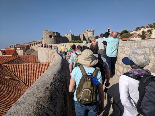 Circumnavigating the city on the tall fortification walls of Dubrovnik, Croatia, offers a bird's eye view of the magnificent medieval old town. UNESCO has declared it a World Heritage Site.
