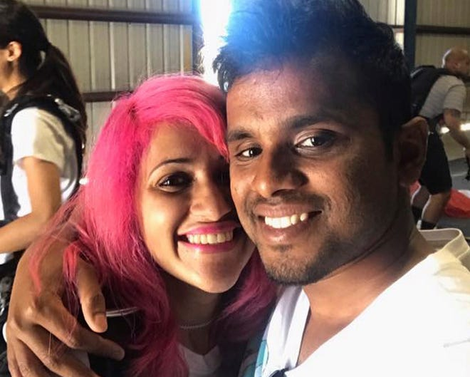 This photo obtained from Facebook posted on June 26, 2017, shows a selfie of Vishnu Viswanath, right, and his wife, Meenakshi Moorthy, at Skydive Santa Barbara in Lompoc. The Indian husband and wife who fell to their deaths from Taft Point at Yosemite National Park while apparently taking a selfie.