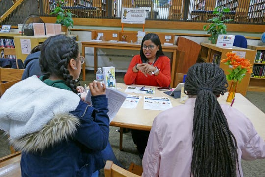 Yocibel Mejia of the Hispanic Family Center speaks with students at Cumberland Regional High School's World Language Fair.