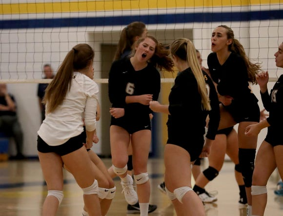 Walter Panas players celebrate a point during their Section 1 Class A volleyball quarterfinal match against Pelham at Walter Panas High School Oct. 30, 2018. Panas defeated Pelham in five sets.