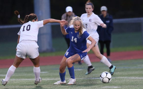 From left, O'Neill's Faith East (10) and  Bronxville's Rachael Peacock (14) battle for ball control in the Class B regional girls soccer semifinal at Arlington High School in Freedom Plains Oct. 31, 2018. Bronxville won the game 2-0.