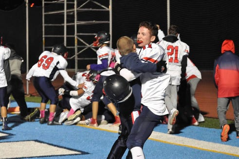 Eastchester's Liam Schultz (11) celebrates after catching a game-winning Hail Mary pass as time expired in the team's game against Suffern on Friday, October 26th, 2018 at Suffern.