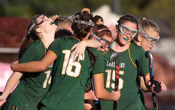 From left, Lakeland's Julianna Cappello (11) is mobbed by teammates after her first half goal against Rondout Valley during the Class B regional semifinal at Dietz Stadium in Kingston Oct. 30, 2018. Lakeland won the game 4-1.