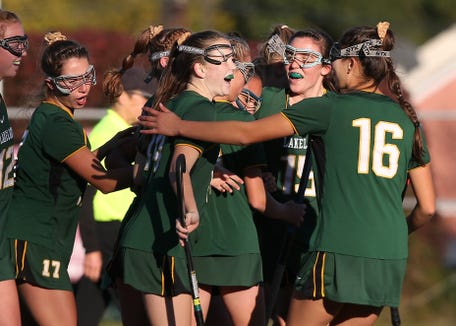 Lakeland's Julianna Cappello (11) is mobbed by teammates after her first half goal against Rondout Valley during Class B regional semifinal at Dietz Stadium in Kingston on Oct. 30. Lakeland won the game 4-1.