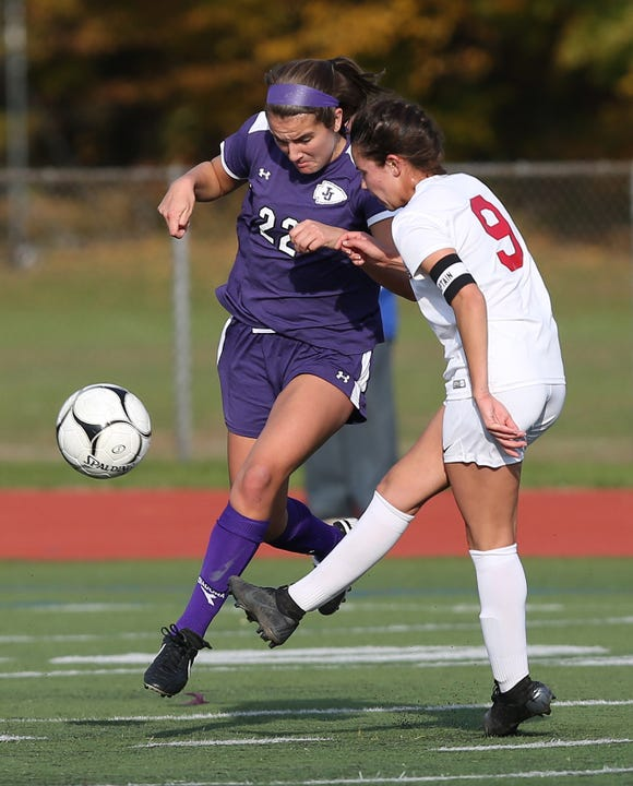 John Jay's Ana Dorta (22) and Goshen's Maddie McGuire (9) battle for ball control during the Class A regional girls soccer semifinal at Arlington High School in Freedom Plains Oct. 31, 2018. John Jay won the game 1-0.