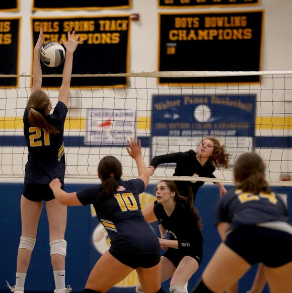Alanna Mansell of Walter Panas tries to get a shot past Grace Aronson of Pelham during their Section 1 Class A volleyball quarterfinal match at Walter Panas High School on Oct. 30, 2018.