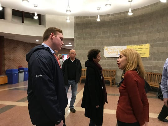 Student Jordan Klein talks to Chappaqua  school board member Victoria Tipp after Tuesday's meeting.
