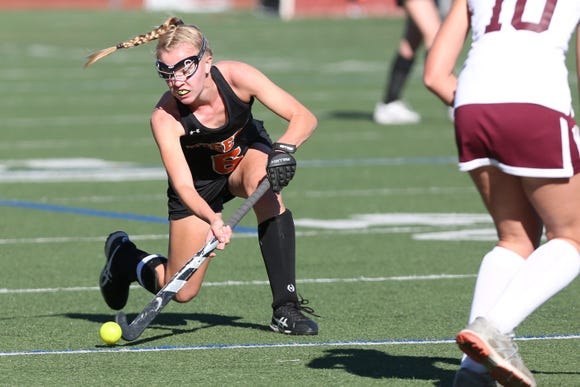Mamaroneck's Elizabeth Brissette (6) fires a shot against Kingston during the field hockey Class A regional semifinal at Dietz Stadium in Kingston Oct. 30, 2018.