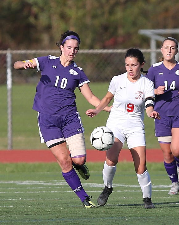 John Jay's Erin Walsh (10) and Goshen's (9) battle for ball control during the Class A regional girls soccer semifinal at Arlington High School in Freedom Plains Oct. 31, 2018. John Jay won the game 1-0 on a goal by Walsh.
