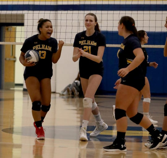 Pelham celebrates a point during their Section 1 Class A volleyball quarterfinal match against Walter Panas at Walter Panas High School Oct. 30, 2018. Panas defeated Pelham in five sets.