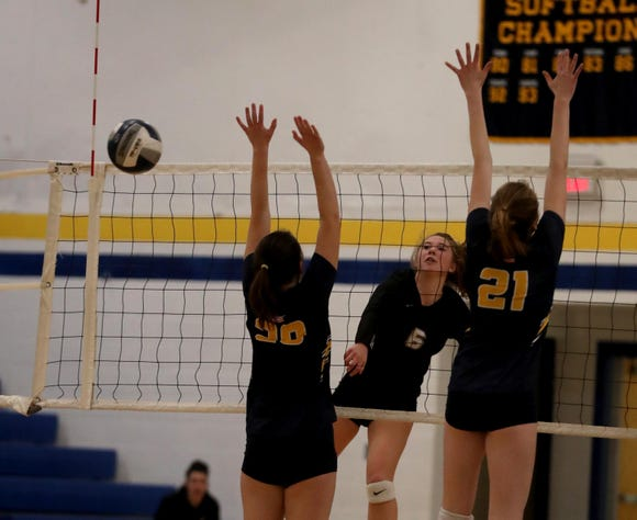 Alan Mansall of Walter Panas gets a shot past Grace Anderson and Grace Aronson of Pelham during their Section 1 Class A volleyball quarterfinal match at Walter Panas High School Oct. 30, 2018. Panas defeated Pelham in five sets.