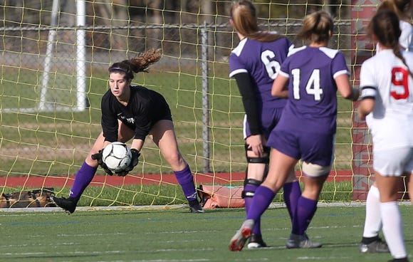 John Jay goal keeper Allison Oestreicher makes a save against Goshen in the Class A regional girls soccer semifinal at Arlington High School in Freedom Plains Oct. 31, 2018. John Jay won the game 1-0.