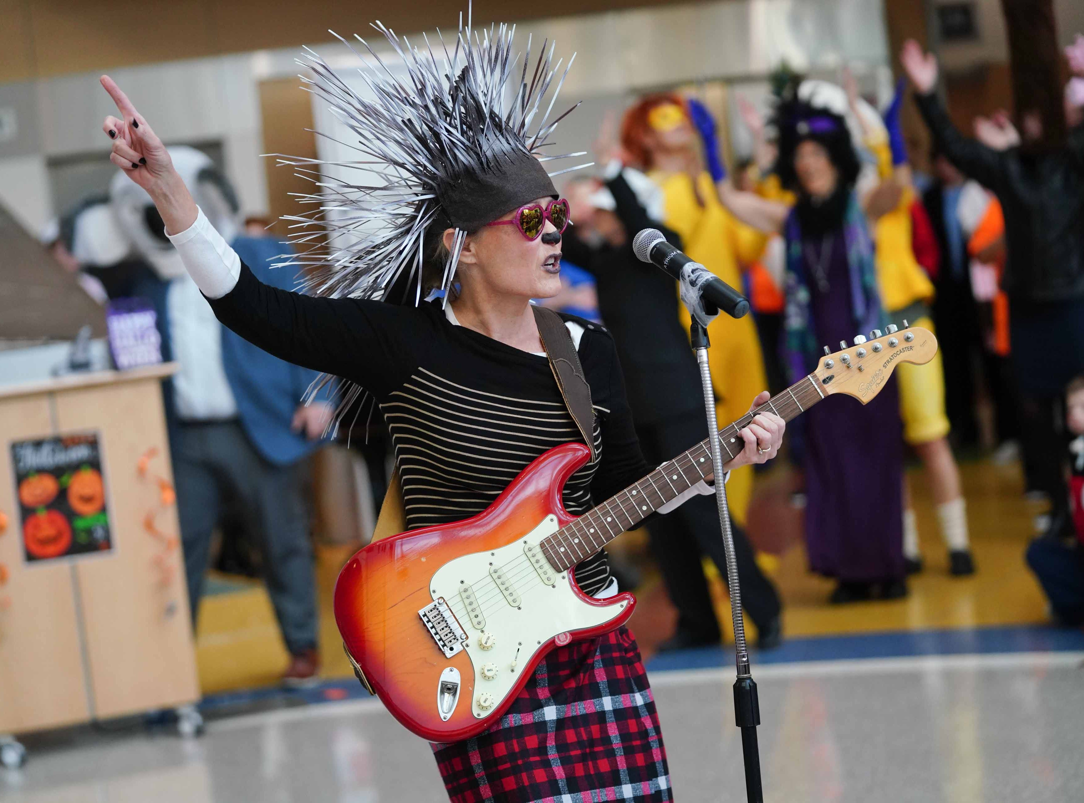 """Dr. Sharon Gould, at Nemours/A.I. duPont Hospital for Children dressed as character Ash from the movie """"Sing"""" for the annual Halloween Lip Sync contest in the hospital's atrium on Halloween. Select patients got to judge the performances for a winner."""