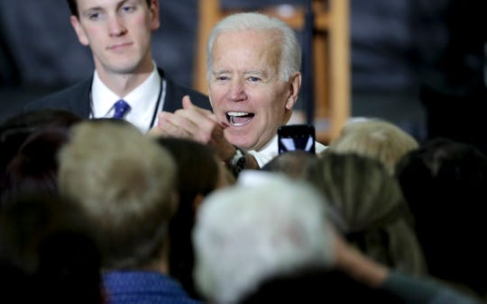 "Former Democratic Vice President Joe Biden greets supporters during a rally with Wisconsin Democrats on the University of Wisconsin-Madison Campus, Tuesday Oct. 30, 2018, in Madison Wis. Biden called for more civility and dignity in politics during a rally, offering a sharp rebuke of President Donald Trump while telling the students they can ""own"" next week's election if they vote.  (Steve Apps/Wisconsin State Journal via AP)"