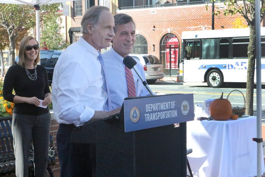 U.S. Sen. Tom Carper and Delaware Gov. John Carney talk Wednesday in downtown Middletown about a $3.4 million federal grant to expand the Delaware Transit Corporation's Mid-County Maintenance Facility in Delaware City and to support an increased fleet of buses serving the Middletown area. Deputy Secretary of Transportation Nicole Majeski looks on.
