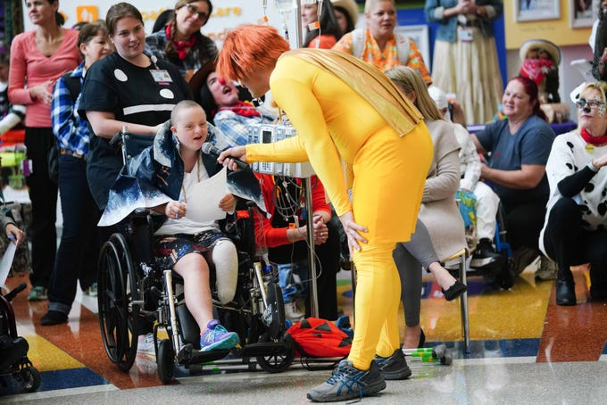 Victoria Marsh, 17, gives her thoughts on performances by staff at Nemours/A.I. duPont Hospital for Children during the annual Halloween Lip Sync contest in the hospital's atrium on Halloween.  Marsh was selected as a judge for the contest.