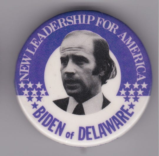 A vintage Biden campaign pin, featuring a stylish mullet.