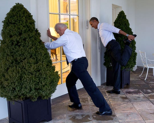 "This official White House photo by Pete Souza shows President Barack Obama and Vice President Joe Biden stretching for  a ""Let's Move!"" video taping in 2014."