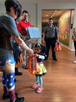 Dover Police officers delivered candy to the Ronald McDonald House of Delaware on Wednesday.