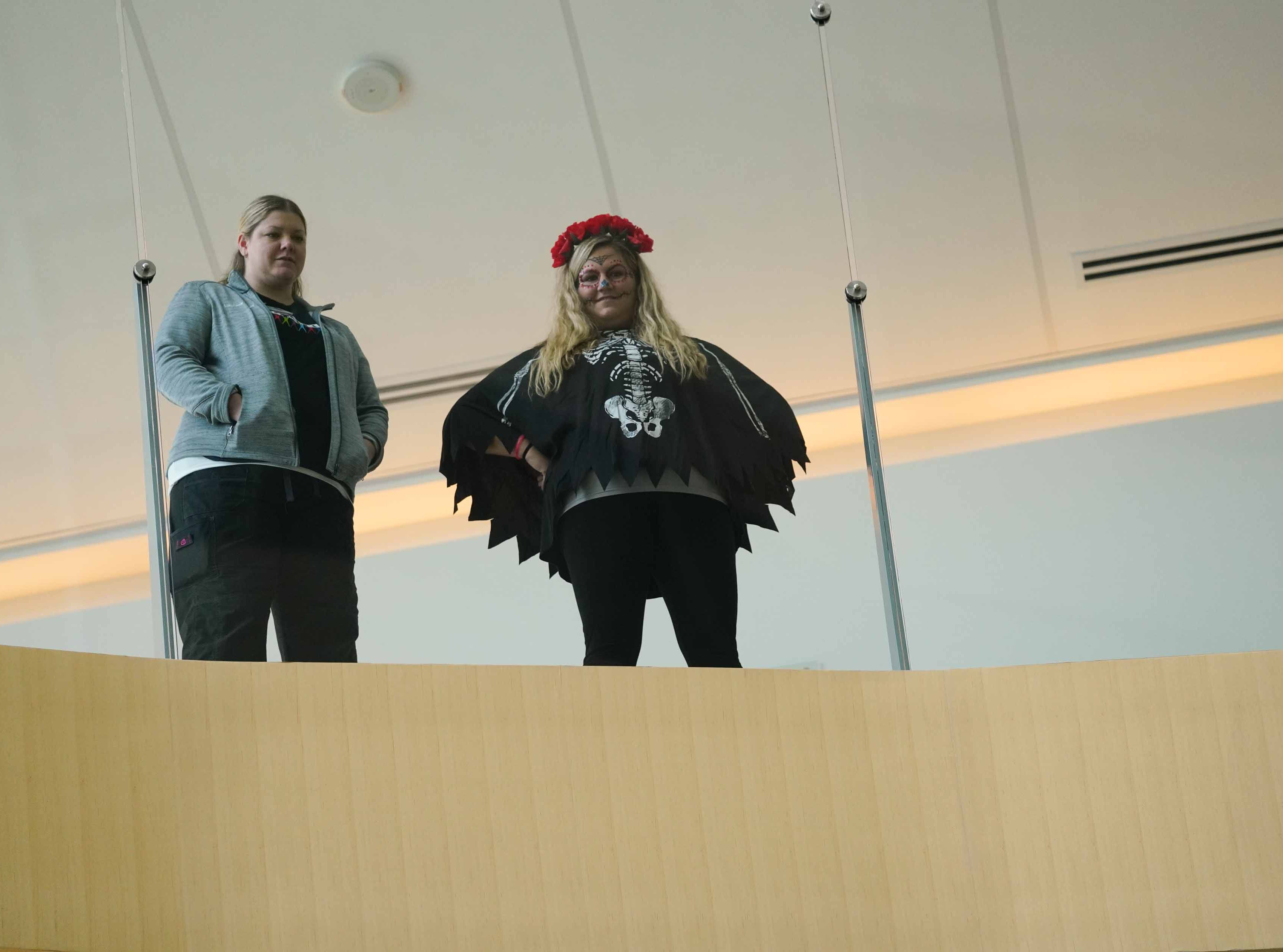 Staff at Nemours/A.I. duPont Hospital for Children watch from floors above the atrium as other staff members dressed in costume entertain patients and family at the annual Halloween Lip Sync contest in the hospital's atrium on Halloween. Select patients got to judge the performances for a winner.
