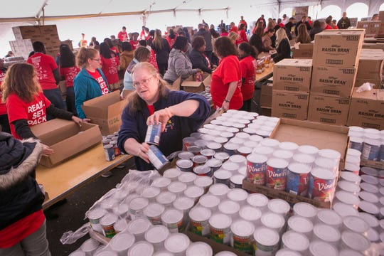 Chase employees volunteer to pack over 3,000 meal boxes for senior citizens for the Food Bank of Delaware which distributes them to community centers that serve seniors.