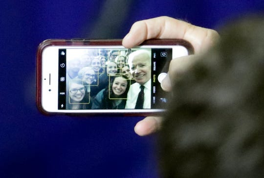 """Former Vice President Joe Biden takes a selfie with students during a rally with Wisconsin Democrats on the University of Wisconsin-Madison Campus, Tuesday Oct. 30, 2018, in Madison Wis. Biden called for more civility and dignity in politics during a rally, offering a sharp rebuke of President Donald Trump while telling the students they can """"own"""" next week's election if they vote.  (Steve Apps/Wisconsin State Journal via AP)"""