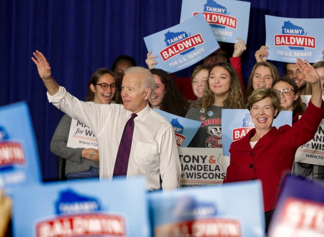 "Former Democratic Vice President Joe Biden and Tammy Baldwin wave during a rally with Wisconsin Democrats on the University of Wisconsin-Madison Campus, Tuesday Oct. 30, 2018, in Madison Wis. Biden called for more civility and dignity in politics during a rally, offering a sharp rebuke of President Donald Trump while telling the students they can ""own"" next week's election if they vote.  (Steve Apps/Wisconsin State Journal via AP)"
