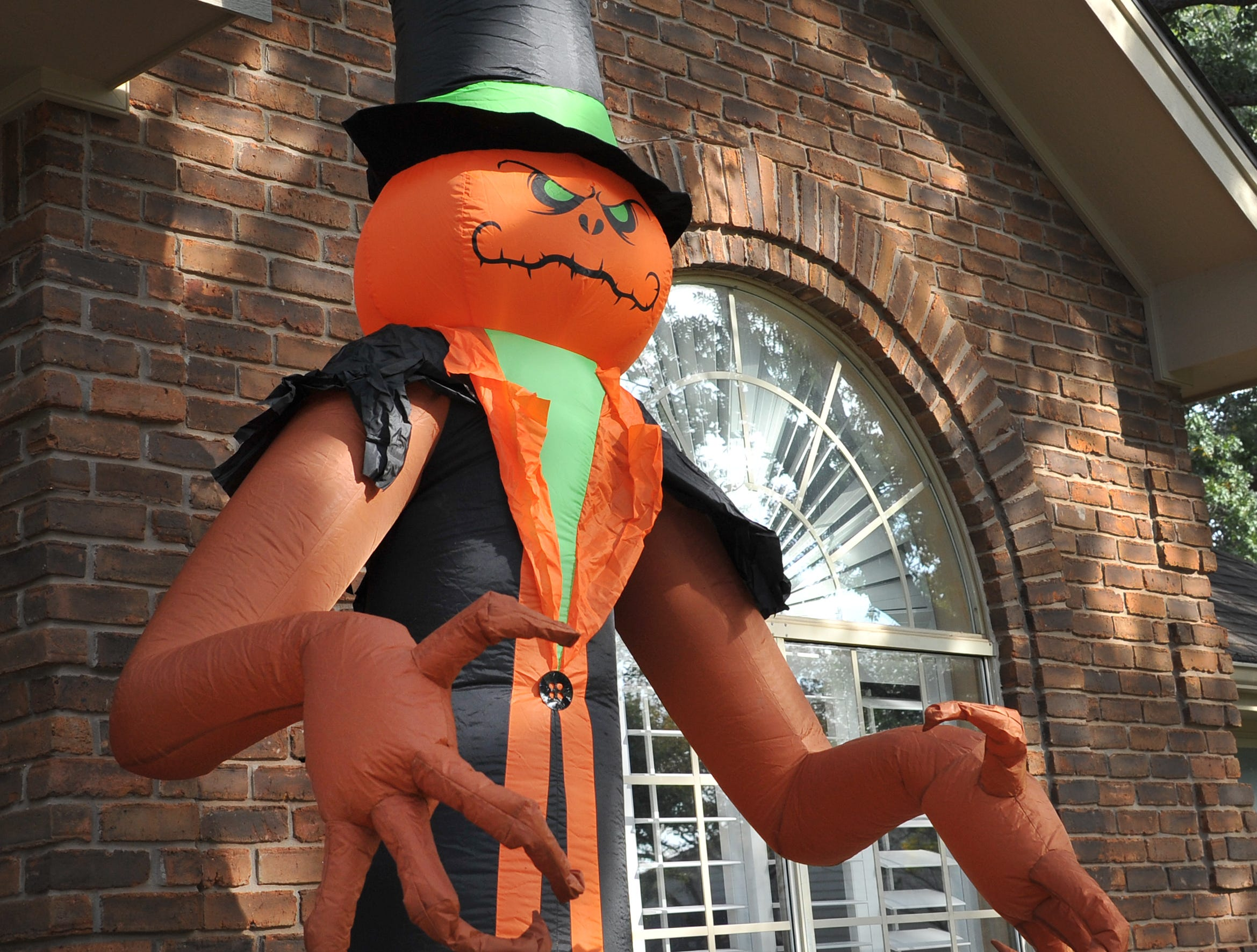 A home in Tanglewood is decorated with a large inflatable ghoul for Halloween.